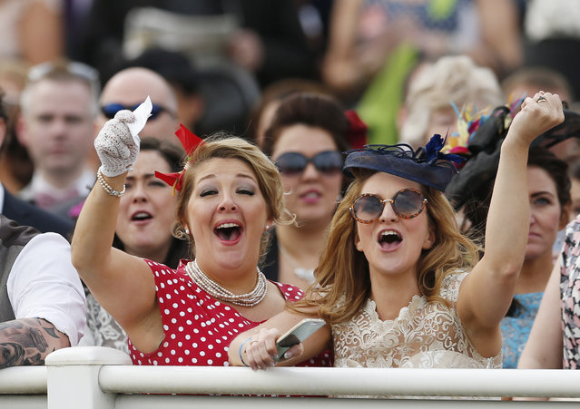 Horse Racing – Crabbie's Grand National Festival – Aintree Racecourse April 10, 2015: Racegoers celebrate during the 14:50 Betfred Mildmay Novices' Chase. (Photo by Andrew Boyers/Reuters)