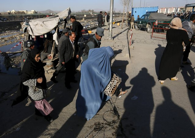 A woman walks on a road blocked near the site of a suicide attack in Kabul, Afghanistan February 27, 2016. (Photo by Mohammad Ismail/Reuters)