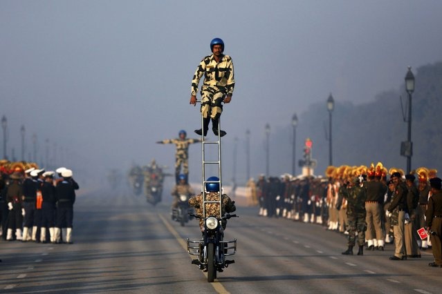 Indian soldiers take part in a rehearsal for the Republic Day parade on a cold winter morning in New Delhi, on January 7, 2014. India celebrates its annual Republic Day on January 26. (Photo by Ahmad Masood/Reuters)