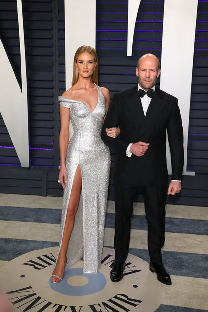 Rosie Huntington-Whiteley (left) and Jason Statham attending the Vanity Fair Oscar Party held at the Wallis Annenberg Center for the Performing Arts in Beverly Hills, Los Angeles, California, USA. (Photo by Ian West/AFP Photo)