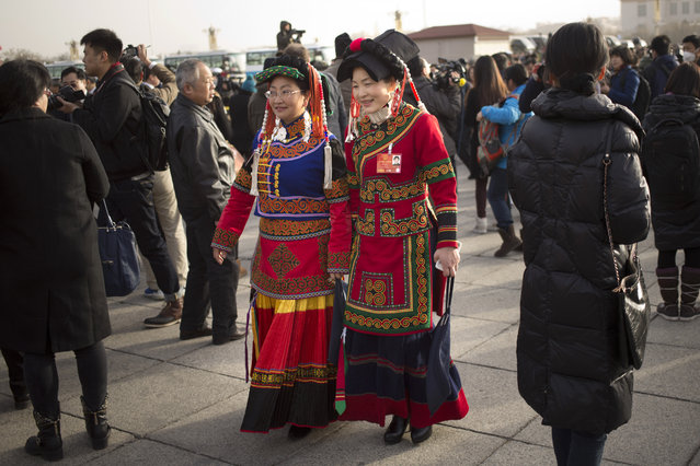 In this Saturday, March 5, 2016 photo, ethnic minority delegates arrive at the Great Hall of the People before the opening session of the National People's Congress (NPC) in Beijing. Unlike legislatures elsewhere, China's does little in the way of legislating, is carefully stage-managed and allows no foreign leader to address it. But like such chambers of power elsewhere, China's has become something of a billionaire's club, where the super-rich sit shoulder-to-shoulder with colorfully adorned Tibetan, Mongolian and other minority delegates and members of the country's vast bureaucracy. (Photo by Mark Schiefelbein/AP Photo)