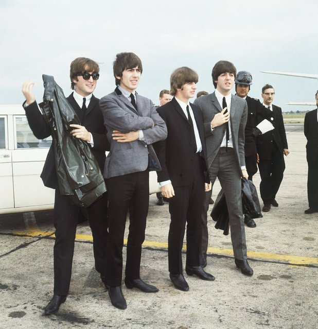 The Beatles leave London airport in 1964. From left:  John Lennon, George Harrison, Ringo Starr and Paul McCartney. (Photo by AP Photo)