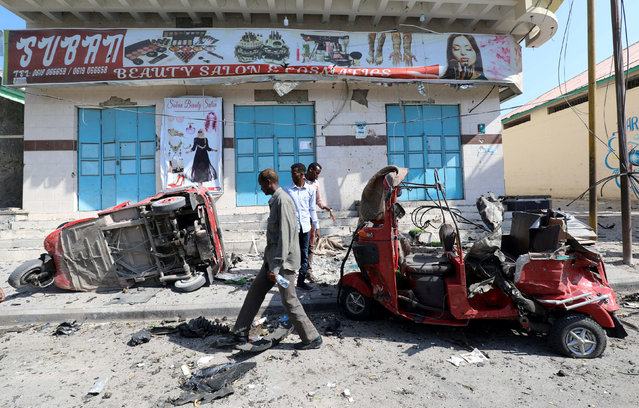 Wreckages of rickshaws are seen destroyed during an explosion near a hotel in Mogadishu, Somalia on March 28, 2019. (Photo by Feisal Omar/Reuters)
