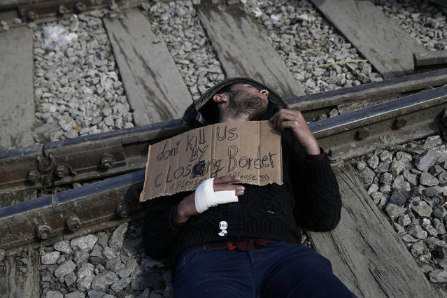 A Syrian refugee protests on railway tracks demanding the opening of the borders, at a makeshift camp at the Greek-Macedonian border near the village of Idomeni, Greece, March 18, 2016. (Photo by Alkis Konstantinidis/Reuters)