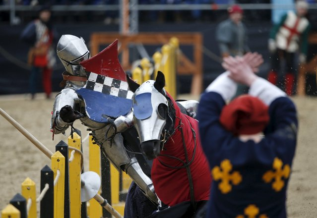 A participant wearing a historic, armoured suit of the Middle Ages falls down from a horse as he competes during the Saint George international knight tournament in Moscow, Russia, May 3, 2015. (Photo by Maxim Zmeyev/Reuters)