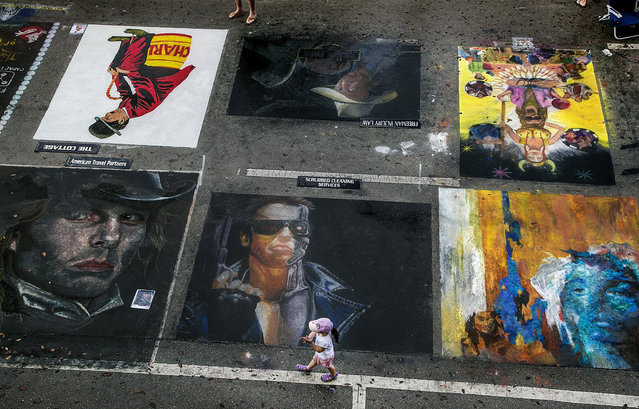 Street paintings fill Lucerne Avenue. (Photo by Greg Lovett/The Palm Beach Post)