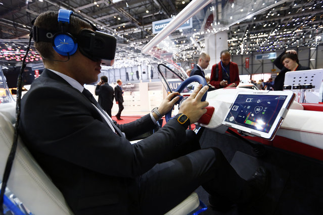 An employee sits inside a virtual reality connected car cockpit built by Segula Technologies during the first press day ahead of the 85th International Motor Show in Geneva March 3, 2015. (Photo by Arnd Wiegmann/Reuters)