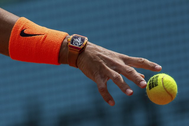 Rafael Nadal, from Spain, serves to Felix Auger-Aliassime, from Canada, during the Madrid Open tennis tournament in Madrid, Wednesday, May 8, 2019. (Photo by Bernat Armangue/AP Photo)