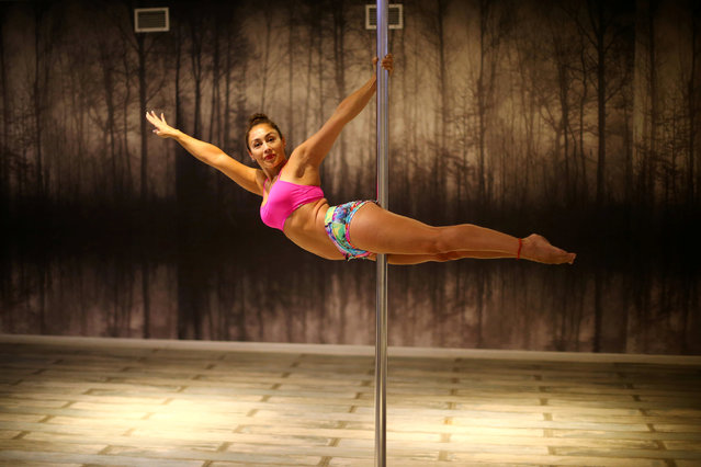 """Claudia Concha Parraguez, 45, a pole dancing instructor, poses for a photograph in a gym in Santiago, Chile February 23, 2017. """"Some students with low self-esteem  smile more and feel beautiful after training. But because of the poor mentality of their husbands, who do not see this activity as a sport and associate it with something sexual, they stop attending classes"""", Parraguez said. (Photo by Ivan Alvarado/Reuters)"""