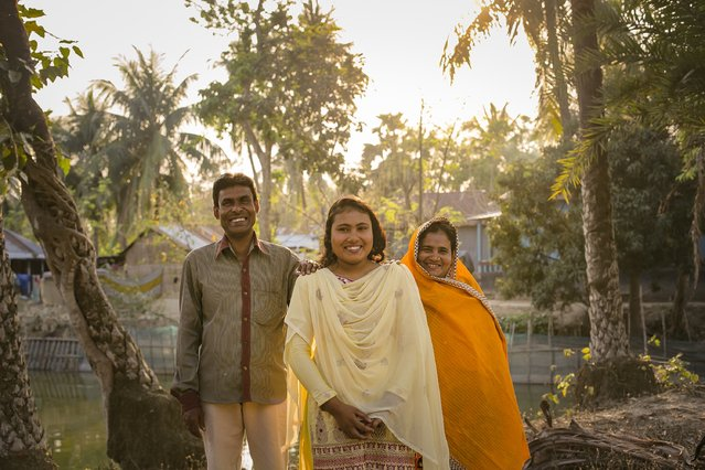 Rani poses for a photo with her father Abdul, and mother Pori, on March 6, 2017 in Khulna division, Bangladesh. (Photo by Allison Joyce/Getty Images)