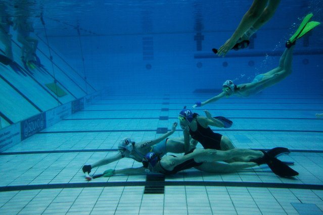 """Originally called """"octopush,"""" underwater hockey was invented back in 1954 by four English divers looking to stay fit during the winter months, when it was too cold to dive the North Sea. The goal is similar to traditional hockey: score by pushing the puck into the other team's net. (Photo by Sol Neelman)"""