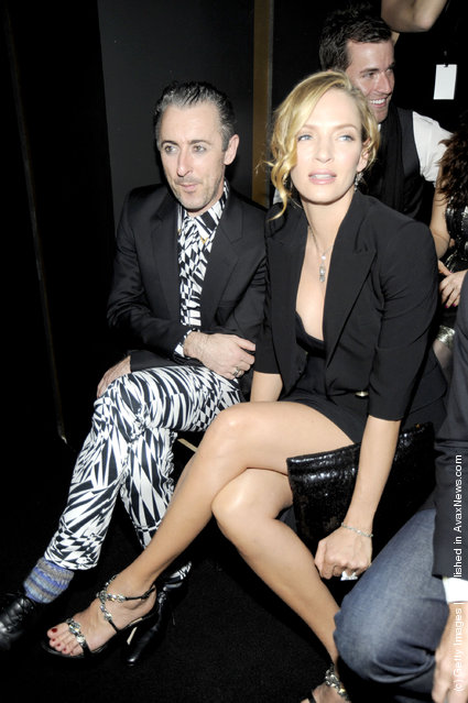 Alan Cumming and Uma Thurman attend the Versace for H&M Fashion event