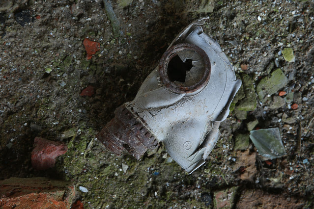 A gas mask lies on the floor of the ruins of a building at the site of the raized village of Akshynka on April 4, 2016 near Chachersk, Belarus. (Photo by Sean Gallup/Getty Images)