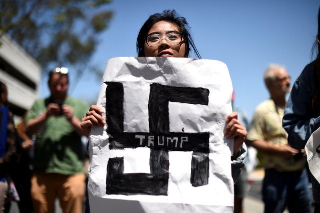 Carla Espinosa holds a protest sign against presidential candidate Donald Trump outside the California Republican Party convention in Burlingame, California April 29, 2016. (Photo by Noah Berger/Reuters)