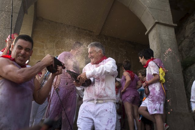 Revellers spray each other with wine during the Batalla de Vino (Wine Battle) in Haro, northern Spain June 29, 2015. (Photo by Vincent West/Reuters)