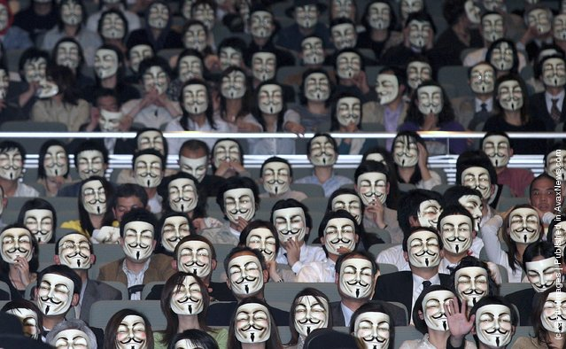 General view of the audience wearing masks during the Japanese premiere of V for Vendetta at Kokusai Forum in Tokyo, Japan