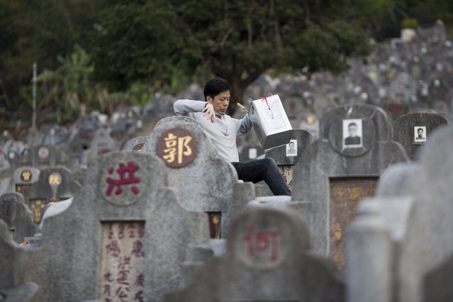 A man makes his way to his deceased relatives' tomb in Diamond Hill cemetery in Hong Kong, China, 04 April 2017. (Photo by Jerome Favre/EPA)
