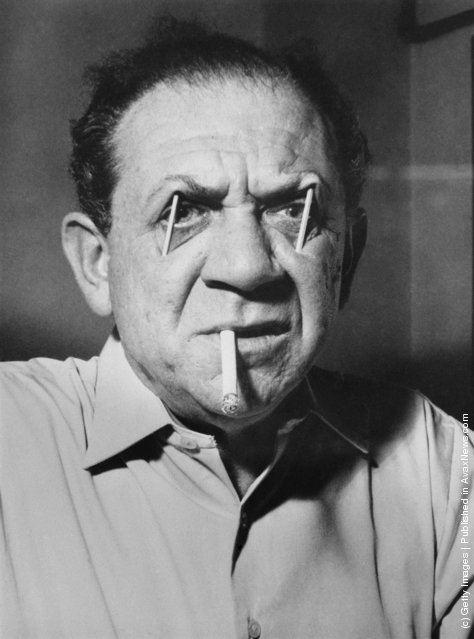 South African-born actor Sid James (1913 - 1976) uses matchsticks to prop up his eyebrows, 23rd December 1959