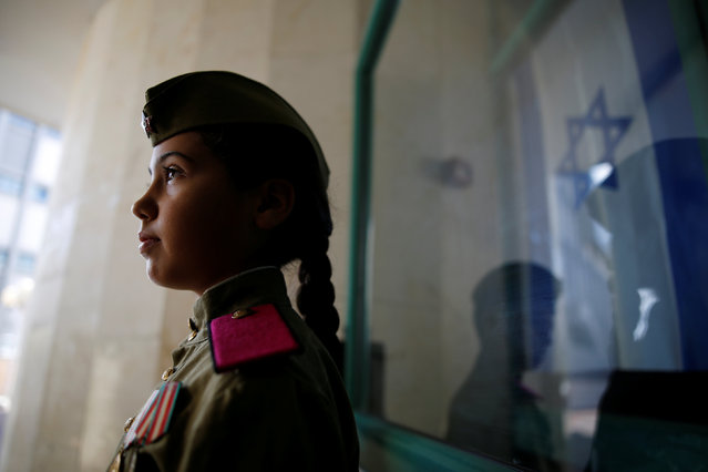 A girl wearing a Red Army uniform is seen during an event in remembrance of the upcoming Victory Day, marking the anniversary of the Allied victory over Nazi Germany, in the southern city of Ashdod, Israel, May 7, 2016. (Photo by Amir Cohen/Reuters)