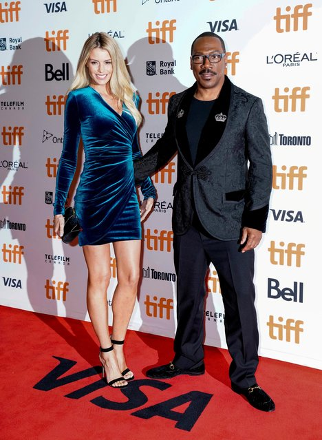 """Eddie Murphy and his girlfriend Paige Butcher attend the """"Dolemite Is My Name"""" premiere during the 2019 Toronto International Film Festival at Princess of Wales Theatre on September 07, 2019 in Toronto, Canada. (Photo by Mark Blinch/Reuters)"""
