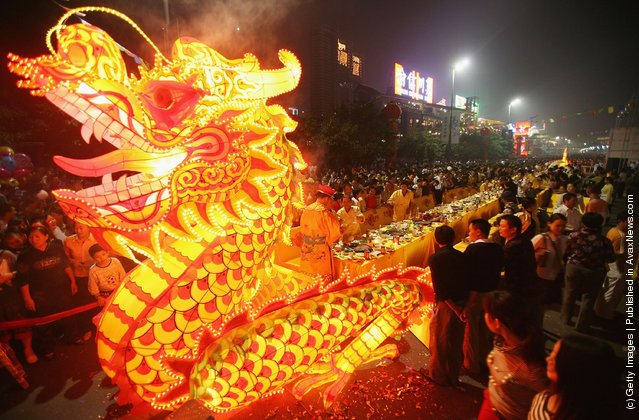 A giant dragon lantern leads a 220-foot-long hot pot feast which can host 170 customers at one time, during the opening ceremony of Chongqing 2nd Hot Pot Festival
