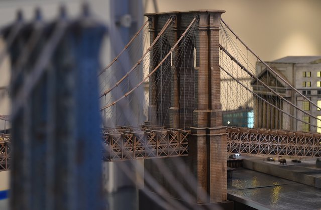 A miniature model of the   Brooklyn Bridge in New York, part of Gulliver's Gate, a miniature world being recreated in a 49,000-square-foot exhibit space in Times Square, is seen during a preview April 10, 2017 in New York City. (Photo by Timothy A. Clary/AFP Photo)