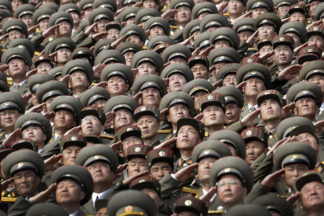 North Korean soldiers salute while the national anthem is played during a military parade on Saturday, April 15, 2017, in Pyongyang, North Korea to celebrate the 105th birth anniversary of Kim Il Sung, the country's late founder and grandfather of current ruler Kim Jong Un. (Photo by Wong Maye-E/AP Photo)