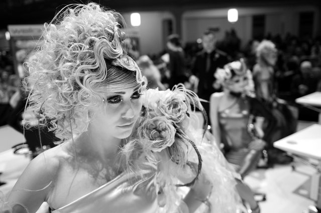 """A Model styled by an german participant waits to be judged by the jury during the contest """"Day style"""" of the OMC Hairworld World Cup on May 4, 2014 in Frankfurt am Main, Germany. (Photo by Thomas Lohnes/Getty Images)"""