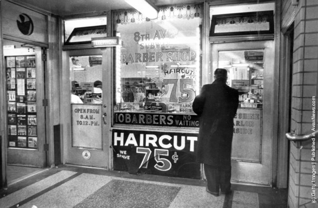 1969:  A man entering a barber shop under Times Square, New York