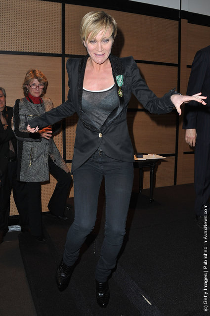 Patricia Kaas poses after being honored by French culture Minister at Hotel Majestic