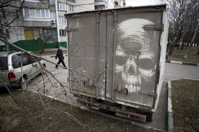 In this photo taken on Saturday, April 22, 2017, a skull is drawn on the back of a dirty truck by artist Nikita Golubev in Moscow, Russia. (Photo by Pavel Golovkin/AP Photo)