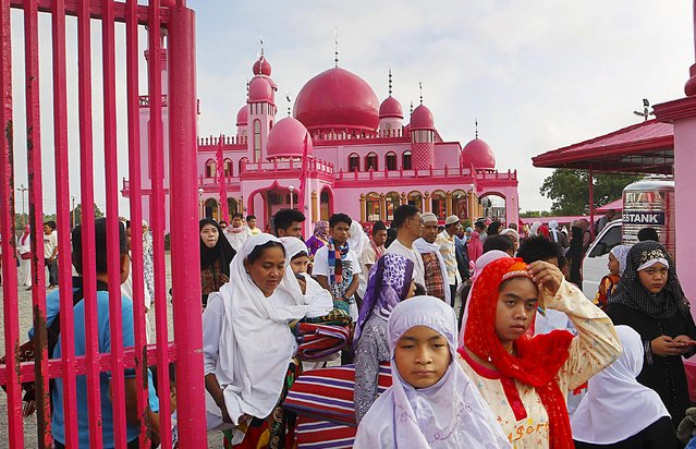 Filipino Muslims leave after attending the morning prayers of Eid al-Fitr holiday, marking the end of the holy month of Ramadan, at the Pink Mosque in Datu Saudi Ampatuan town, Maguindanao province in southern Philippines July 17, 2015. (Photo by Marconi Navales/Reuters)