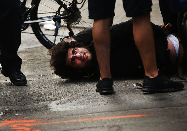 A protester is arrested as he marches with others from New York's Union Square on May Day on May 1, 2017 in New York, New York. Across the country and world people are protesting, marching and staying home from work on the traditional day of workers rights.This year's event has taken on extra significance due to the global surge in populist and right-wing movements. (Photo by Spencer Platt/Getty Images)