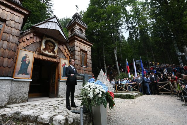Russian Prime Minister Dmitry Medvedev speaks outside the Russian Orthodox Cathedral dedicated to Russian prisoners of war died during WWI near Ljubljana, Slovenia, Sunday, July  26, 2015. (Photo by Yekaterina Shtukina/RIA Novosti, Government Press Service Pool photo via AP Photo)
