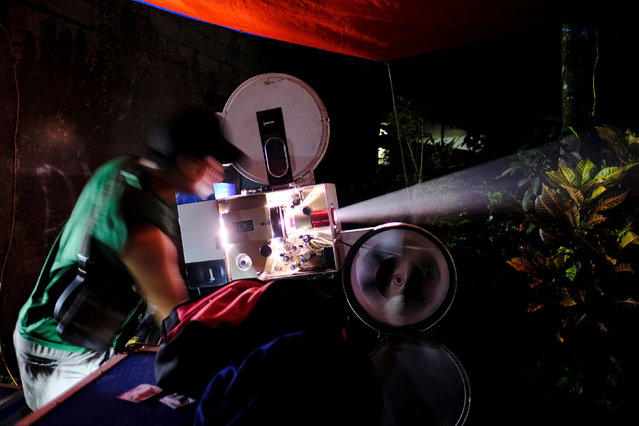 An operator adjusts a film projector during a wedding party in Bogor, Indonesia, February 18, 2017. (Photo by Reuters/Beawiharta)