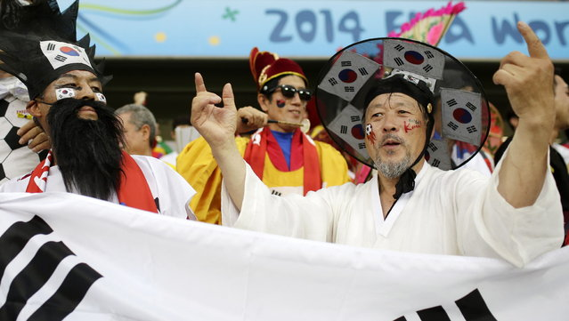 South Korean fans in fancy outfits cheer before the group H World Cup soccer match between Russia and South Korea at the Arena Pantanal in Cuiaba, Brazil, Tuesday, June 17, 2014. (Photo by Felipe Dana/AP Photo)