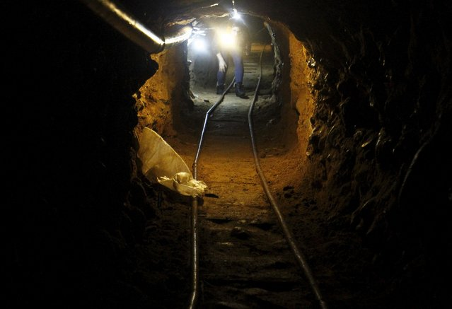 A journalist walks through a tunnel discovered by the Mexican Army, during a presentation to the media in Tijuana, Mexico August 2, 2015. According to local media, authorities found the tunnel, which is still under construction at the northern city of Tijuana which borders with the United States. (Photo by Jorge Duenes/Reuters)