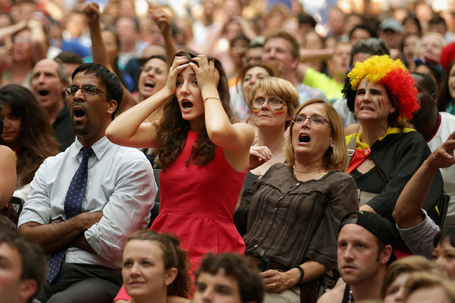 Some of an estimated 1,000 people gather to watch the World Cup soccer match between Belgium and the United States in the Kogod Courtyard of the Smithsonian National Portait Gallery July 1, 2014 in Washington, United States. Belgium won the match 2-1. (Photo by Chip Somodevilla/Getty Images)
