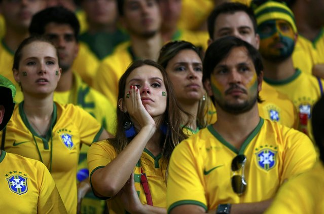 Brazil fans react during the 2014 World Cup semi-finals between Brazil and Germany at the Mineirao stadium in Belo Horizonte July 8, 2014. (Photo by Eddie Keogh/Reuters)