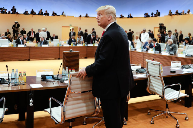 U.S. President Donald Trump arrives for a working session at the G-20 summit in Hamburg, northern Germany, Saturday, July 8, 2017. The leaders of the group of 20 meet July 7 and 8. (Photo by Markus Schreiber/AP Photo)