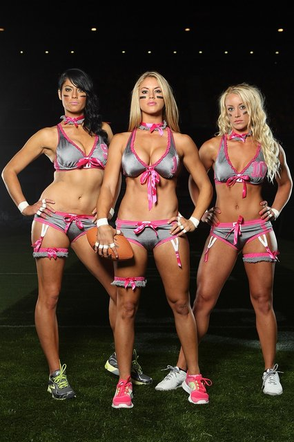 Angela Perfetto, Liz Gorman and Ashley Helmstetter of the Eastern conference pose during the Lingerie Football League media call at Brisbane Entertainment  centre on May 30, 2012 in Brisbane, Australia