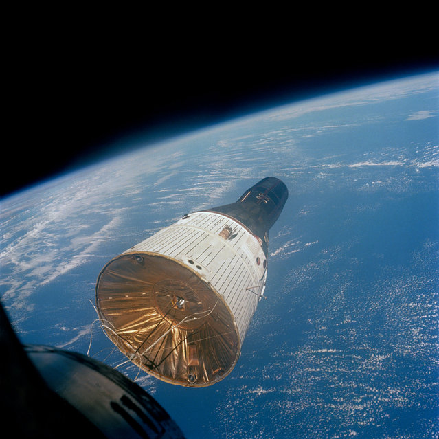 This photograph of the Gemini-Titan 7 (GT-7) spacecraft was taken from the Gemini-Titan 6 (GT-6) spacecraft during the historic rendezvous of the two spacecraft on December 15, 1965. The two spacecraft are some 37 feet apart here. Earth can be seen below. Astronauts Walter M. Schirra Jr., command pilot; and Thomas P. Stafford, pilot, were inside the GT-6 spacecraft, while crewmen for the GT-7 mission were astronauts Frank Borman, command pilot, and James A. Lovell Jr., pilot. (Photo by NASA)