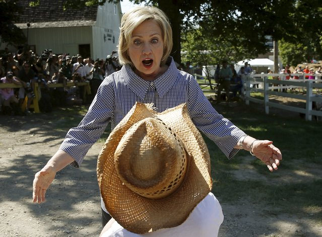U.S. Democratic presidential candidate Hillary Clinton greets Louie Dixon as she campaigns at the Iowa State Fair in Des Moines, Iowa, United States, August 15, 2015. (Photo by Jim Young/Reuters)
