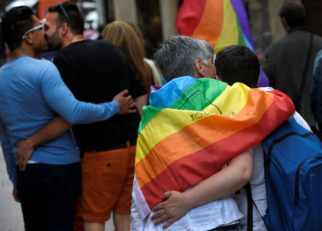 Couples kiss during a LGBT Pride parade in Oviedo, northern Spain, June 28, 2016. (Photo by Eloy Alonso/Reuters)