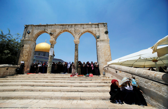 Palestinian women pray on the last Friday of the holy fasting month of Ramadan on the compound known to Muslims as Noble Sanctuary and to Jews as Temple Mount in Jerusalem's Old City July 1, 2016. (Photo by Ammar Awad/Reuters)