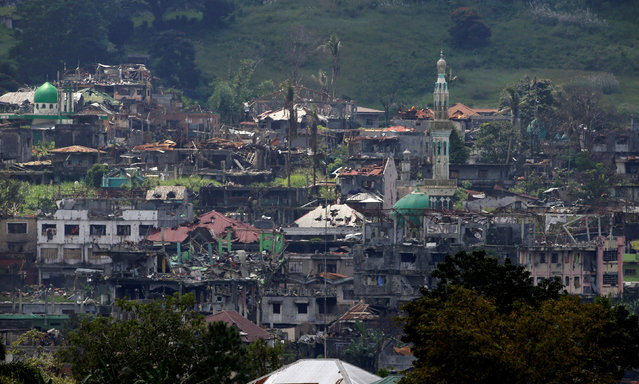 Damaged buildings and houses are seen as government troops continue their assault on its 105th day of clearing operations against pro-IS militants who have seized control of large parts of Marawi city, southern Philippines September 4, 2017. (Photo by Romeo Ranoco/Reuters)