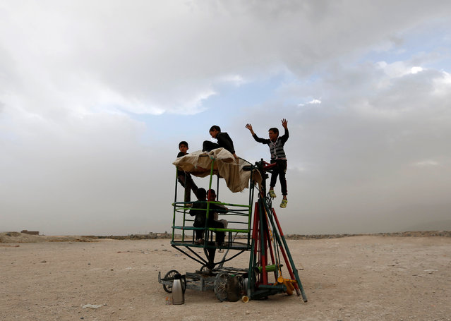 Afghan boys play with a broken swing in Kabul, Afghanistan July 17, 2016. (Photo by Mohammad Ismail/Reuters)