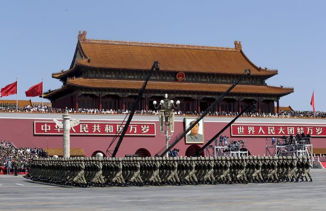 Soldiers of China's People's Liberation Army (PLA) march past Tiananmen Gate during the military parade marking the 70th anniversary of the end of World War Two, in Beijing, China, September 3, 2015. (Photo by Jason Lee/Reuters)