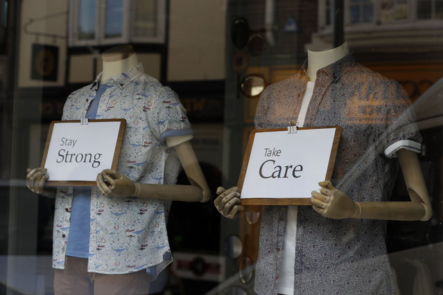 Messages of support are seen in a shop window in Windsor, England Tuesday, March 24, 2020. Britain's Prime Minister Boris Johnson on Monday imposed its most draconian peacetime restrictions due to the spread of the coronavirus on businesses and gatherings. (Photo by Kirsty Wigglesworth/AP Photo)