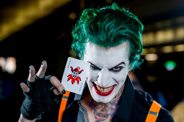 A fan cosplays as the Joker from Batman and the DC universe during 2017 New York Comic Con, Day 2 on October 6, 2017 in New York City. (Photo by Roy Rochlin/WireImage)